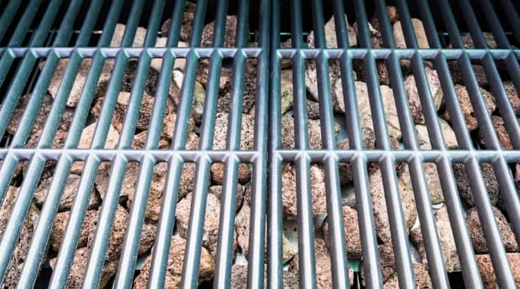 lava rocks in gas grill, under a chrome or SS grate