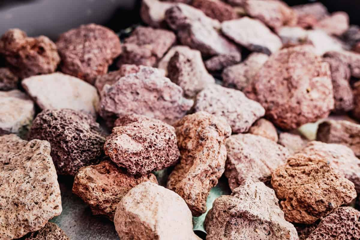 Close up of beige and brown lava rocks meant for use in grills