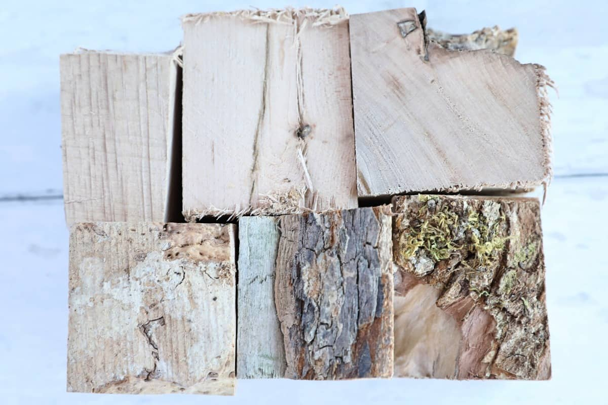 Six maple wood chunks on a light colored wooden surface
