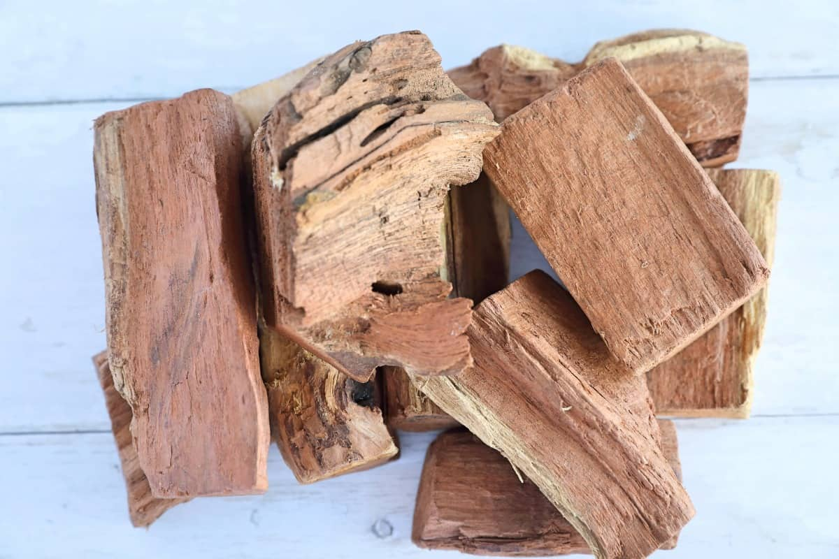 A pile of mesquite chunks on a light wooden table