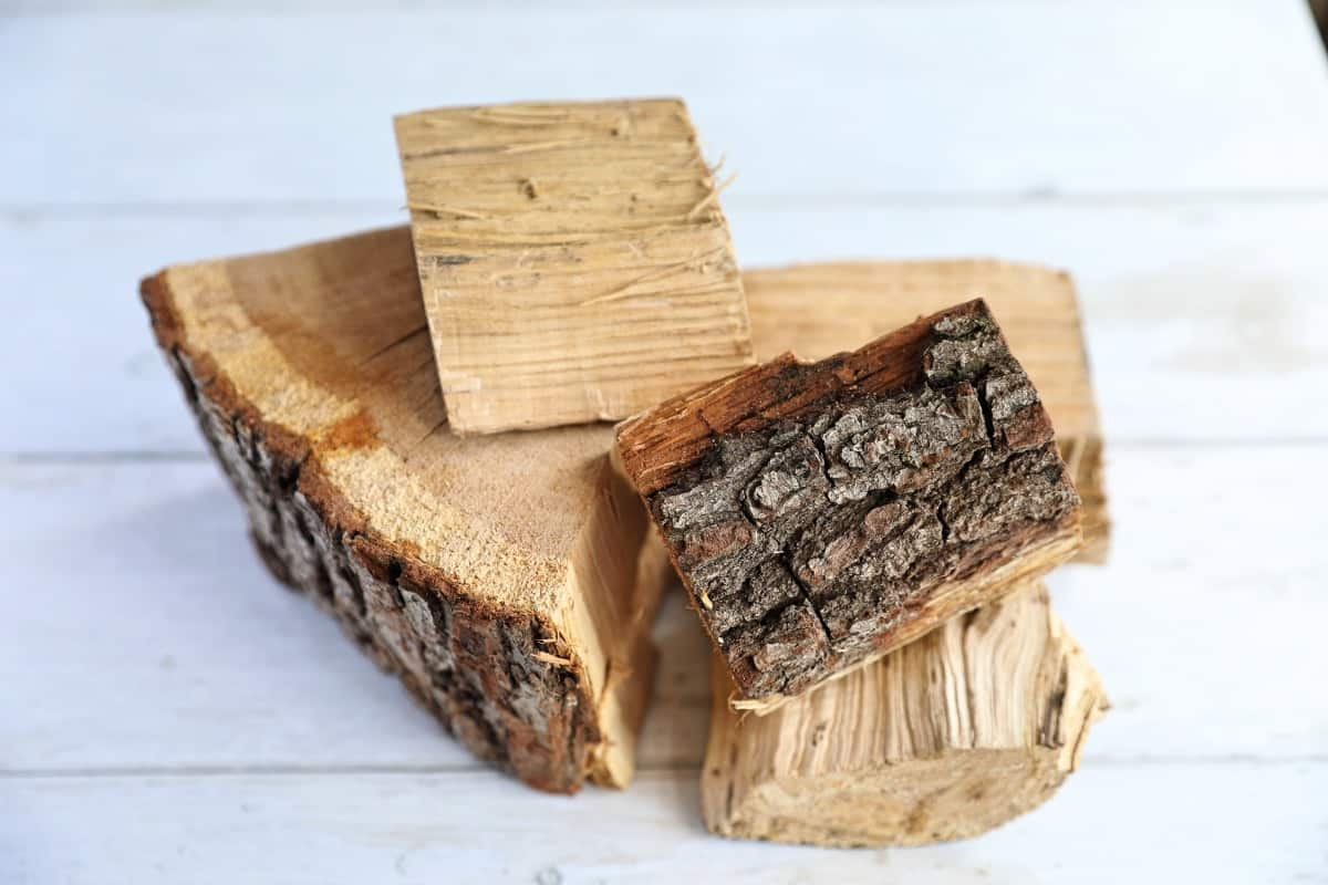 Chunks of oak smoking wood on a white wooden background