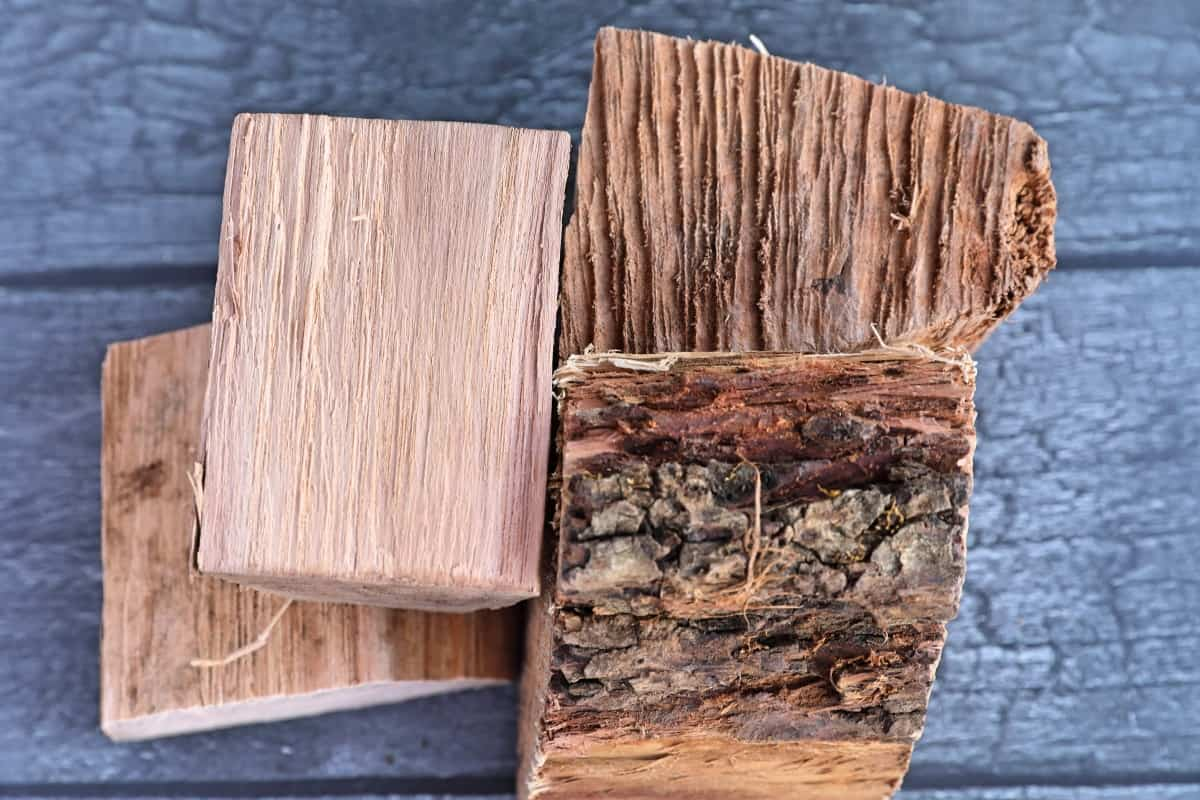 Pecan wood chunks on a grey wooden background
