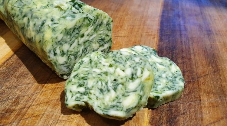 Close up of sliced wild garlic compound butter
