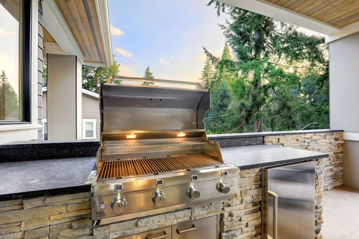 A built in gas grill as part of an outdoor kitchen