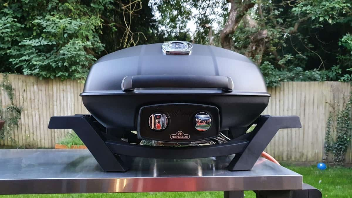 Napoleon 285 pro portable gas grill on a stainless steel table