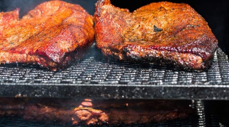 Brisket smoking on a two tier grill or BBQ