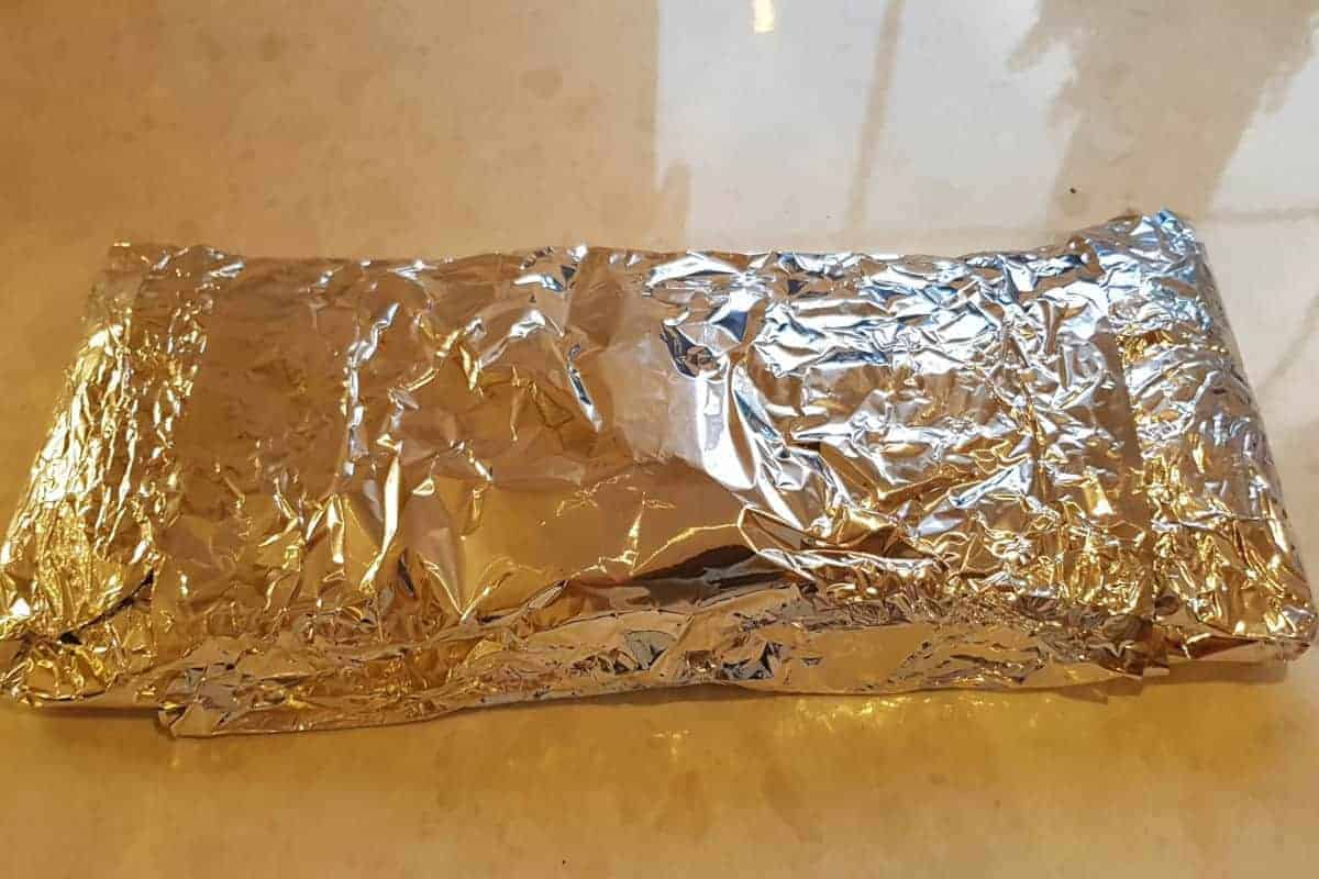 Foil wrapped ribs on a kitchen counter